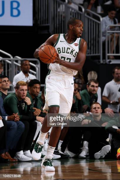 Khris Middleton of the Milwaukee Bucks handles the ball against the Chicago Bulls during a preseason game on October 3 2018 at Fiserv Forum in...