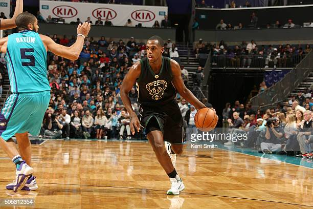 Khris Middleton of the Milwaukee Bucks handles the ball against the Charlotte Hornets on January 16 2016 at Time Warner Cable Arena in Charlotte...