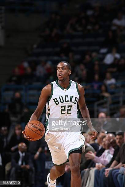 Khris Middleton of the Milwaukee Bucks handles the ball against the Phoenix Suns on March 30 2016 at the BMO Harris Bradley Center in Milwaukee...