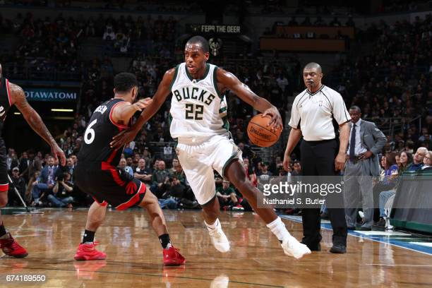Khris Middleton of the Milwaukee Bucks handles the ball against the Toronto Raptors during Game Six of the Eastern Conference Quarterfinals of the...