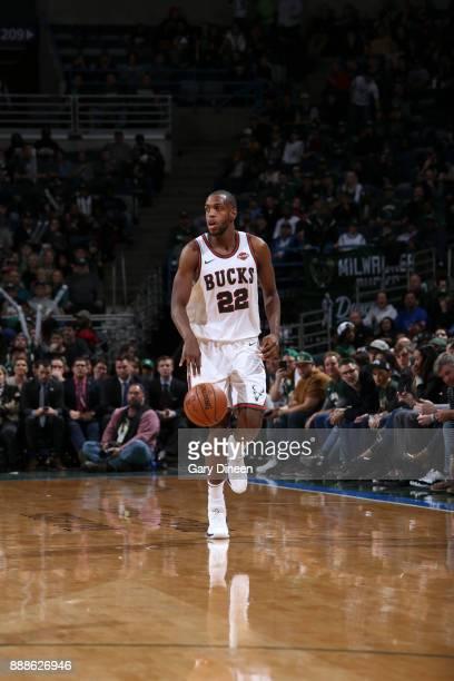 Khris Middleton of the Milwaukee Bucks handles the ball against the Dallas Mavericks on December 8 2017 at the Bradley Center in Milwaukee Wisconsin...
