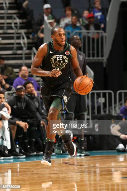 Khris Middleton of the Milwaukee Bucks handles the ball against the Charlotte Hornets on December 23 2017 at the Spectrum Center in Charlotte North...