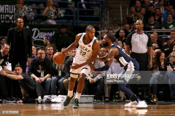 Khris Middleton of the Milwaukee Bucks handles the ball against the Denver Nuggets on February 15 2018 at the BMO Harris Bradley Center in Milwaukee...