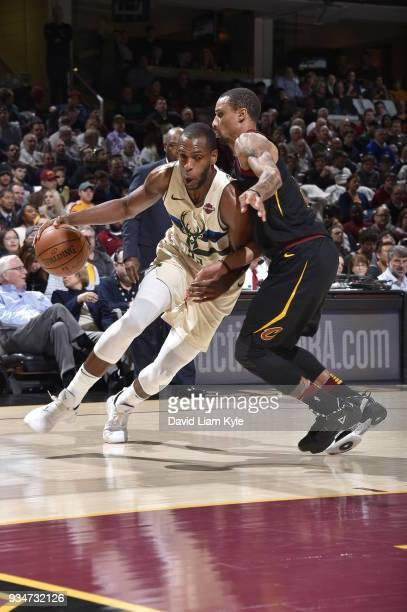 Khris Middleton of the Milwaukee Bucks handles the ball against the Cleveland Cavaliers on March 19 2018 at Quicken Loans Arena in Cleveland Ohio...