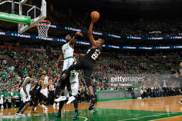 Khris Middleton of the Milwaukee Bucks handles the ball against the Boston Celtics in Game One of Round One during the 2018 NBA Playoffs on April 15...