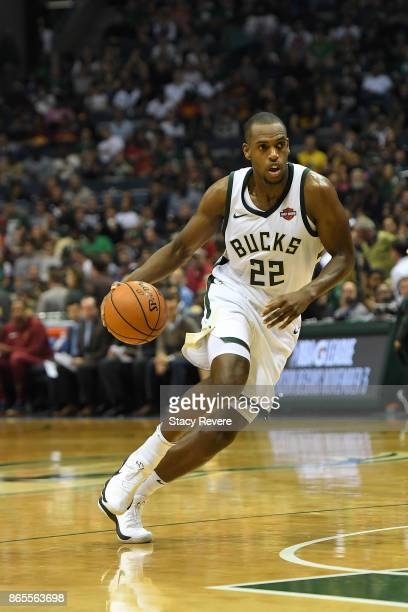 Khris Middleton of the Milwaukee Bucks handles the ball during a game against the Cleveland Cavaliers at the Bradley Center on October 20 2017 in...