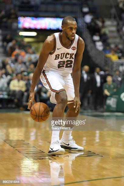 Khris Middleton of the Milwaukee Bucks handles the ball during a game against the Dallas Mavericks at the Bradley Center on December 8 2017 in...