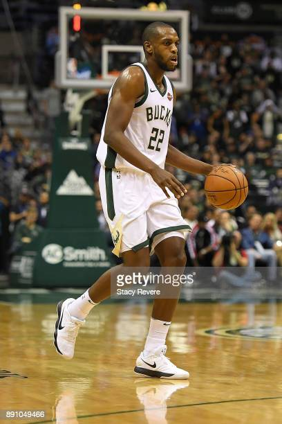 Khris Middleton of the Milwaukee Bucks handles the ball during a game against the Utah Jazz at the Bradley Center on December 9 2017 in Milwaukee...