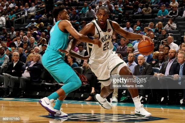 Khris Middleton of the Milwaukee Bucks handles the ball during the game against the Charlotte Hornets on November 1 2017 at Spectrum Center in...