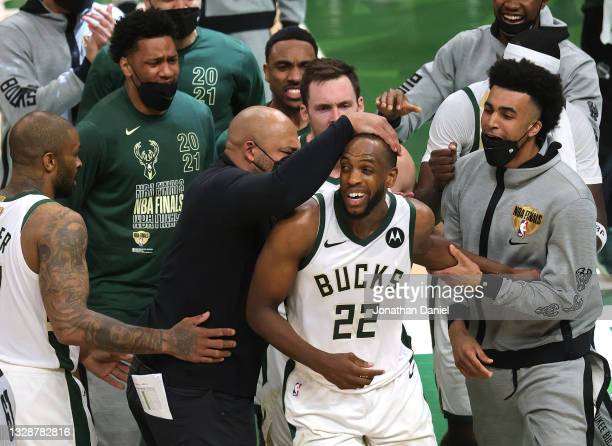 Khris Middleton of the Milwaukee Bucks is congratulated by teammates during the second half in Game Four of the NBA Finals against the Phoenix Suns...
