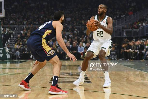 Khris Middleton of the Milwaukee Bucks is defended by Kenrich Williams of the New Orleans Pelicans during the first half of a game at Fiserv Forum on...