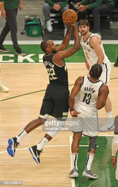 Khris Middleton of the Milwaukee Bucks is fouled while shooting by James Harden of the Brooklyn Nets at Fiserv Forum on June 17, 2021 in Milwaukee,...