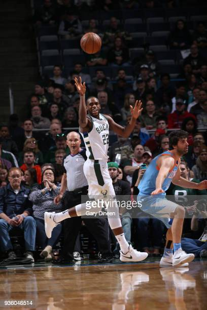 Khris Middleton of the Milwaukee Bucks passes against Milos Teodosic of the Los Angeles Clippers during the NBA game on March 21 2018 at the BMO...