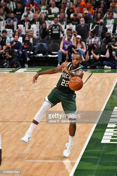 Khris Middleton of the Milwaukee Bucks passes the ball against the Phoenix Suns during Game Three of the 2021 NBA Finals on July 11, 2021 at Fiserv...