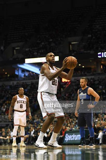 Khris Middleton of the Milwaukee Bucks shoots a free throw during a game against the Dallas Mavericks at the Bradley Center on December 8 2017 in...