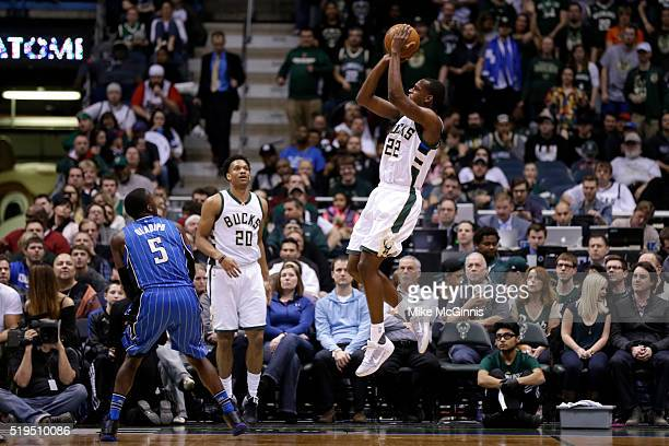 Khris Middleton of the Milwaukee Bucks shoots a three pointer during the third quarter against the Orlando Magic during the third quarter against the...