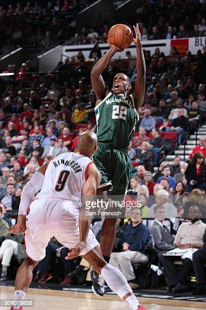 Khris Middleton of the Milwaukee Bucks shoots against Gerald Henderson of the Portland Trail Blazers during the game on February 2 2016 at Moda...