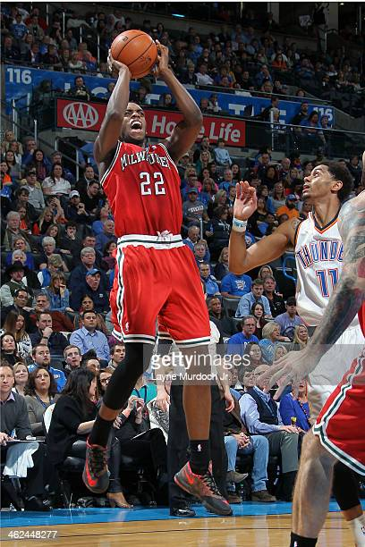 Khris Middleton of the Milwaukee Bucks shoots against the Oklahoma City Thunder on January 11 2014 at the Chesapeake Energy Arena in Oklahoma City...