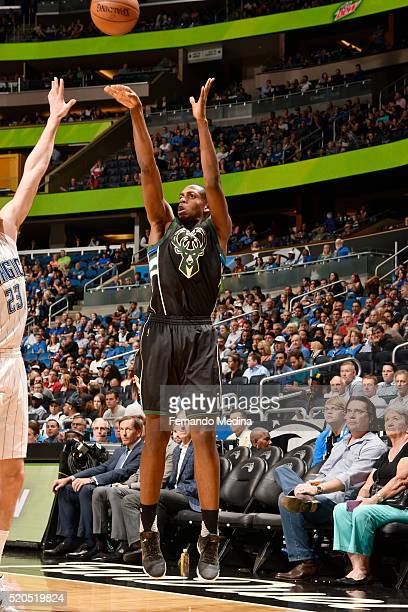 Khris Middleton of the Milwaukee Bucks shoots against the Orlando Magic during the game on April 11 2016 at Amway Center in Orlando Florida NOTE TO...