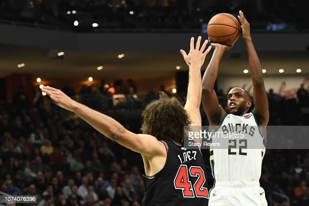 Khris Middleton of the Milwaukee Bucks shoots over Robin Lopez of the Chicago Bulls during the second half of a game at Fiserv Forum on November 28...