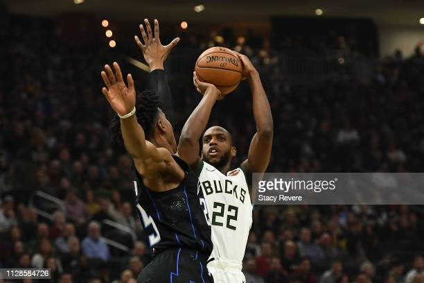 Khris Middleton of the Milwaukee Bucks shoots over Wesley Iwundu of the Orlando Magic during the first half of a game at Fiserv Forum on February 09...