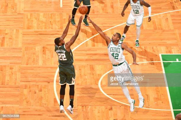 Khris Middleton of the Milwaukee Bucks shoots the ball against Al Horford of the Boston Celtics in Game Seven of the 2018 NBA Playoffs on April 28...