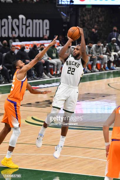 Khris Middleton of the Milwaukee Bucks shoots the ball against the Phoenix Suns during Game Four of the 2021 NBA Finals on July 14, 2021 at Fiserv...