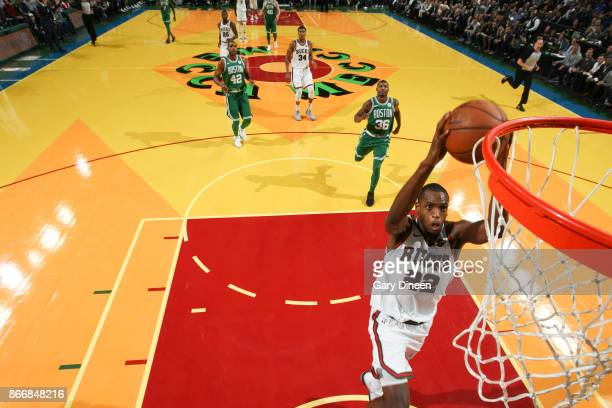 Khris Middleton of the Milwaukee Bucks shoots the ball against the Boston Celtics on October 26 2017 at the UWMilwaukee Panther Arena in Milwaukee...