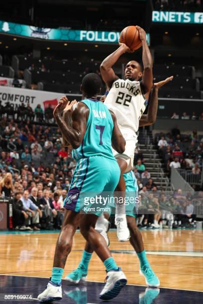Khris Middleton of the Milwaukee Bucks shoots the ball against the Milwaukee Bucks on November 1 2017 at Spectrum Center in Charlotte North Carolina...