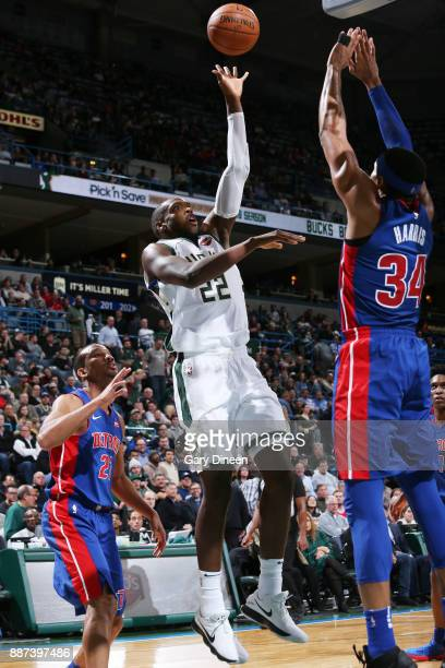 Khris Middleton of the Milwaukee Bucks shoots the ball against the Detroit Pistons on December 6 2017 at the BMO Harris Bradley Center in Milwaukee...