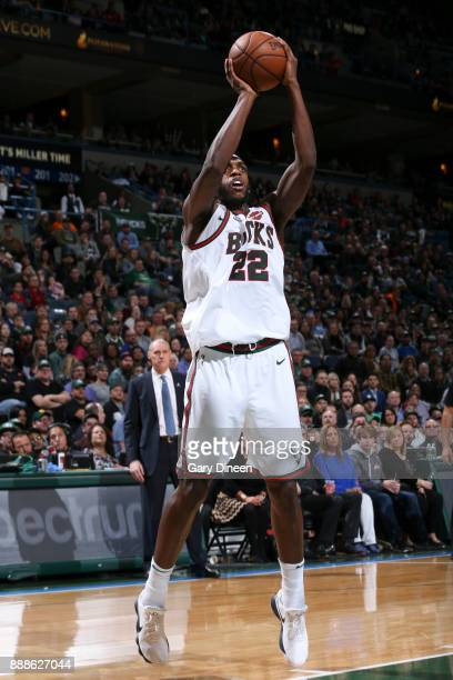 Khris Middleton of the Milwaukee Bucks shoots the ball against the Dallas Mavericks on December 8 2017 at the Bradley Center in Milwaukee Wisconsin...
