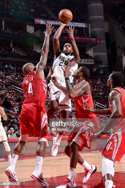 Khris Middleton of the Milwaukee Bucks shoots the ball against the Houston Rockets on December 16 2017 at the Toyota Center in Houston Texas NOTE TO...