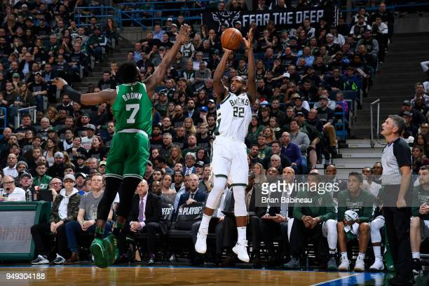 Khris Middleton of the Milwaukee Bucks shoots the ball against the Boston Celtics in Game Three of Round One of the 2018 NBA Playoffs on April 20...