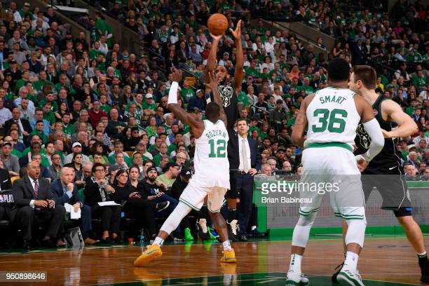 Khris Middleton of the Milwaukee Bucks shoots the ball against the Boston Celtics Game Five of Round One of the 2018 NBA Playoffs on April 24 2018 at...