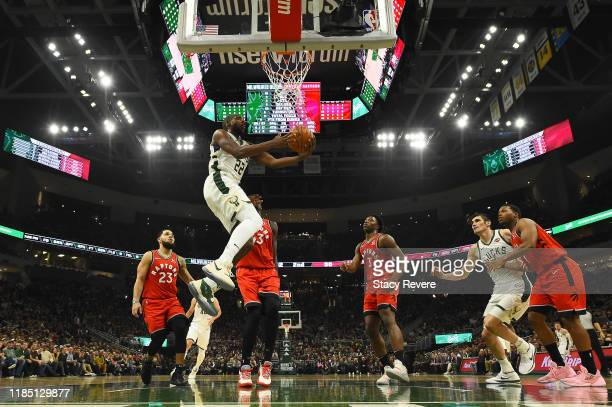 Khris Middleton of the Milwaukee Bucks takes a shot during the first half of a game against the Toronto Raptors at Fiserv Forum on November 02 2019...