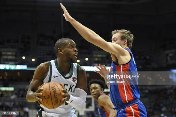 Khris Middleton of the Milwaukee Bucks works against Luke Kennard of the Detroit Pistons during the first half of a game at the Bradley Center on...