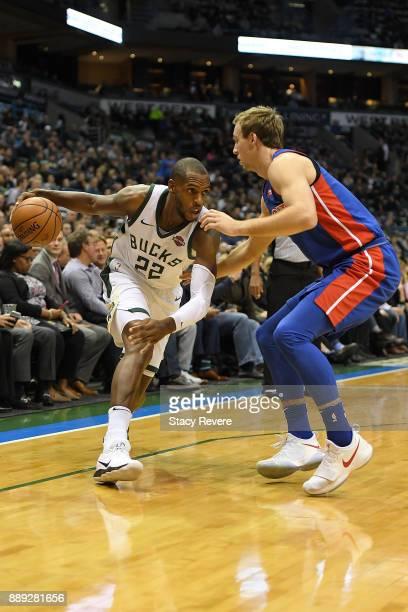 Khris Middleton of the Milwaukee Bucks works against Luke Kennard of the Detroit Pistons during a game at the Bradley Center on December 6 2017 in...