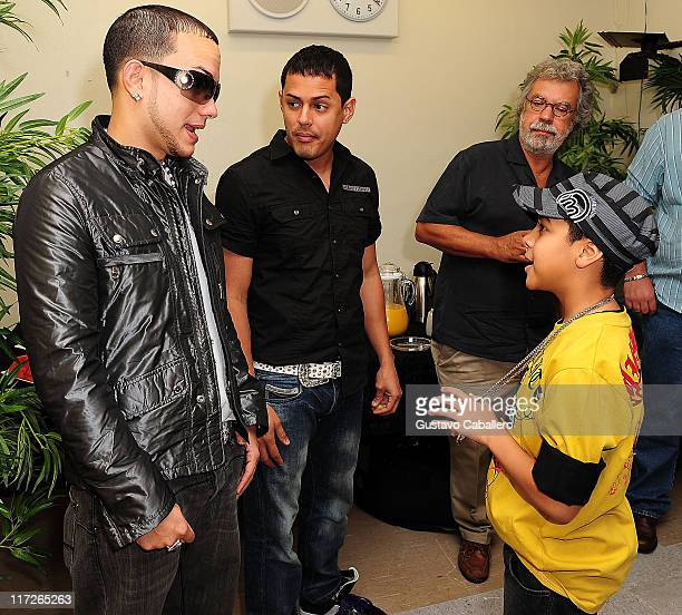 Khriz Angel and Miguelito attends the Latin GRAMMY in the Schools at Miami Coral Park Senior High School on October 9 2009 in Miami Florida