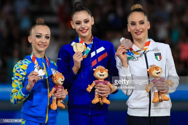 Khrystyna Pohranychna of Ukraine Daria Trubnikova of Russia and Talisa Torretti of Italy during the medal ceremony of Women's Individual AllAround...