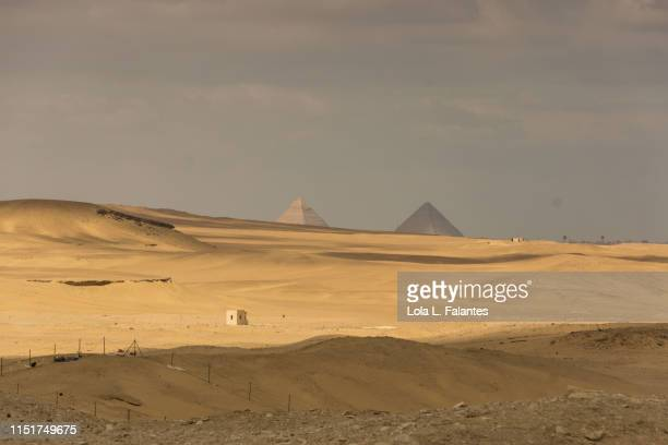 Khufu and Khafre pyramids seen from the desert