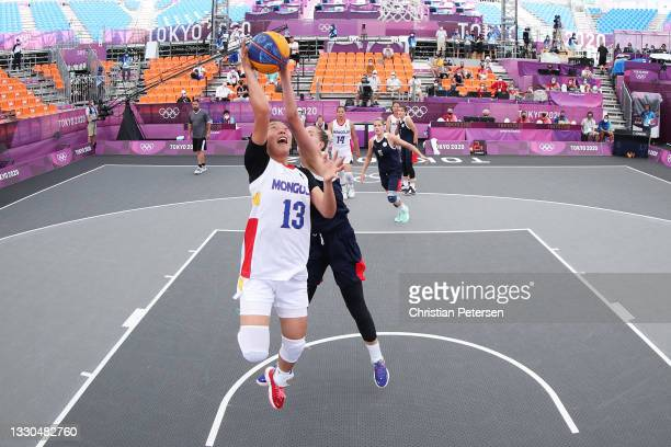 Khulan Onolbaatar of Team Mongolia drives to the basket during the Women's Pool Round match between Mongolia and ROC on day two of the Tokyo 2020...