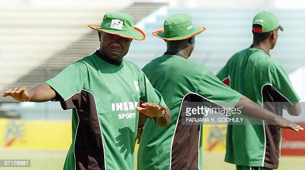 Kenyan cricket captain Stephen Tikolo stretches with teammates during net practice prior to the the second One Day International between Bangladesh...