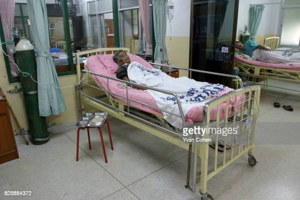 Khun Duong Panyaraew lies on a hospital bed in Mae Moh district He has been diagnosed with Chronic Obstructive Pulmonary Disease Environmental...
