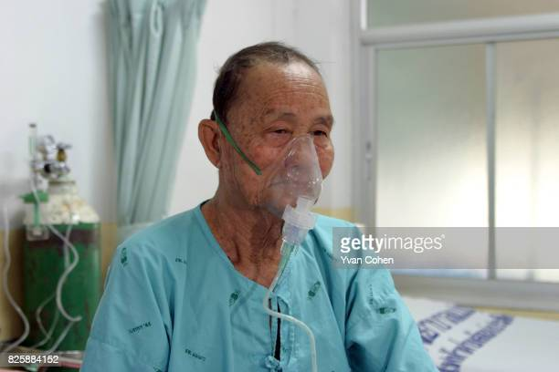 Khun Khao Jaiwang breathes with the help of an oxygen tank at Mae Moh district hospital He has been diagnosed with Chronic Obstructive Pulmonary...