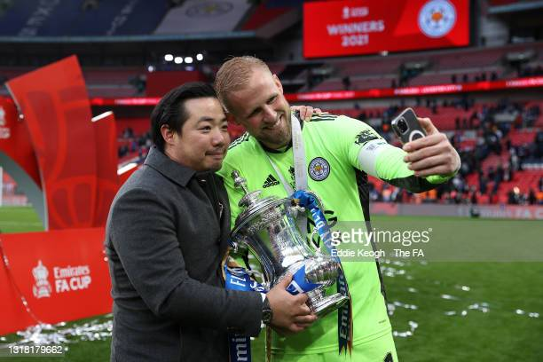 Khun Top, Chairman of Leicester City and Kasper Schmeichel of Leicester City celebrate with the Emirates FA Cup trophy following The Emirates FA Cup...