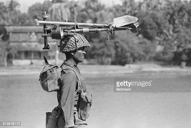 Indian soldier heads for home with his field gear on his head after the battle for Khunla 12/16 Pres Agha Mohammed Yahya Khan of Pakistan bowed 12/17...