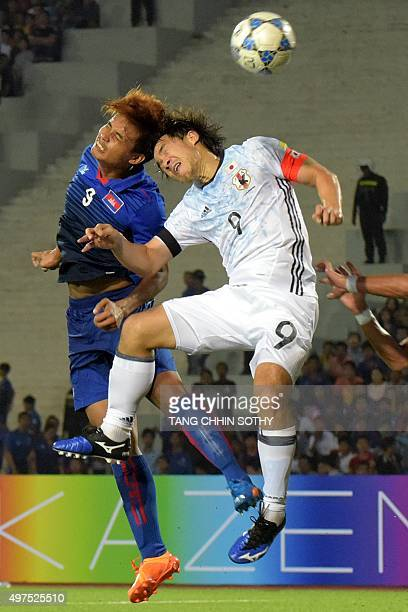 Khuon Laboravy of Cambodia battles for the ball with Shinji Okazaki of Japan during group E football match in round 2 of the 2018 FIFA World Cup...