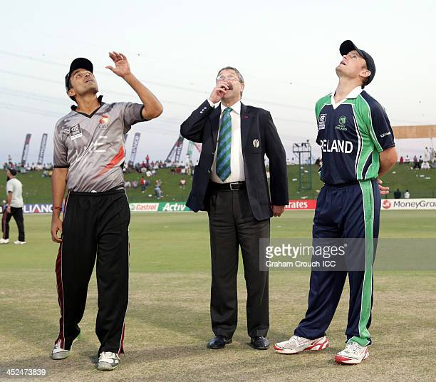 Khurram Khan captain of UAE tosses the coin with match referee David Jukes and William Porterfield captain of Ireland ahead of the Ireland v UAE Semi...