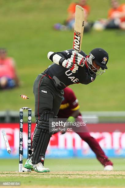 Khurram Khan of the UAE is bowled out by Jerome Taylor of the West Indies during the 2015 ICC Cricket World Cup match between the West Indies and...