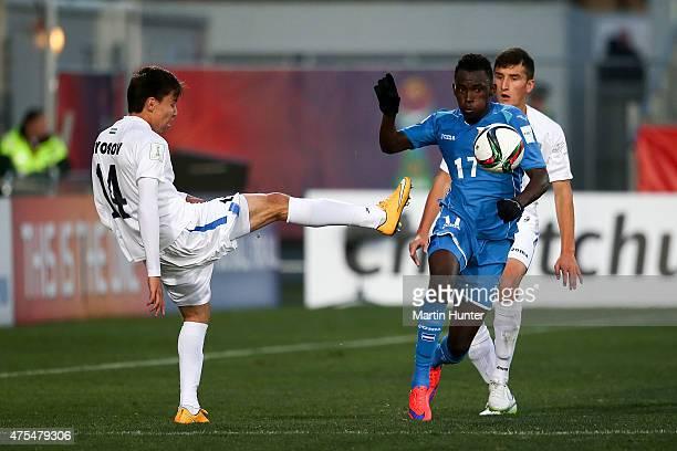 Khurshid Giyosov of Uzbekistan battles with Alberth Elis of Honduras during the Group E Group E FIFA U20 World Cup New Zealand 2015 match between...